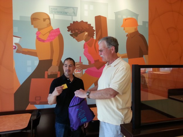 Winning tickets were drawn by Yu Shin Chen (Manager) at Dunkin' Donuts in Hyde Park while Board Member Walt Czachorowski looks on.